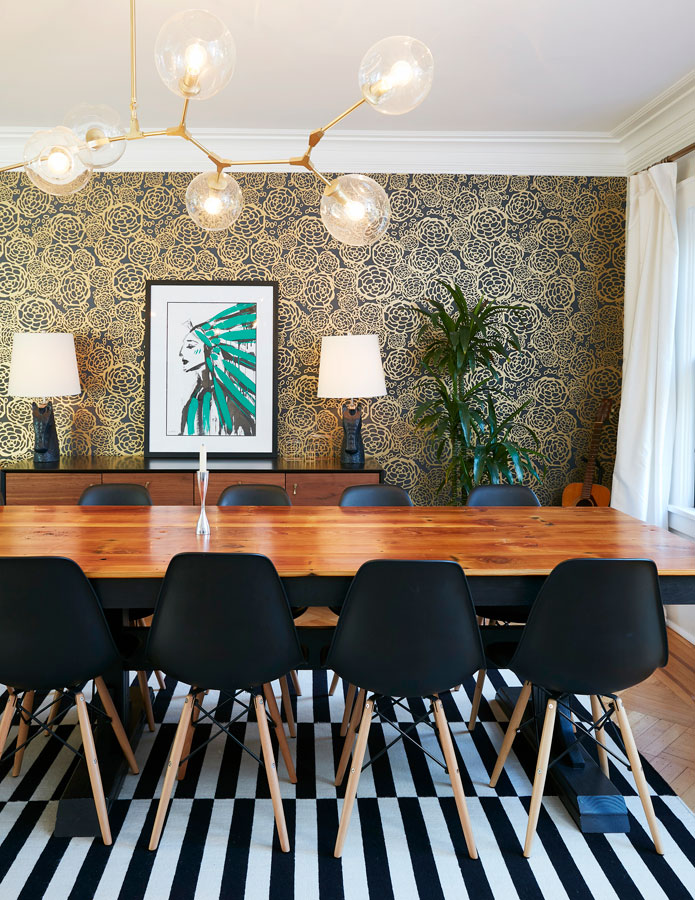 Stunning gold and greyish-black wallpaper looks different in changing light and compliments a custom-made painting featuring an American Indian Chief by a New York City artist, in Alexis' favorite pop color, green.