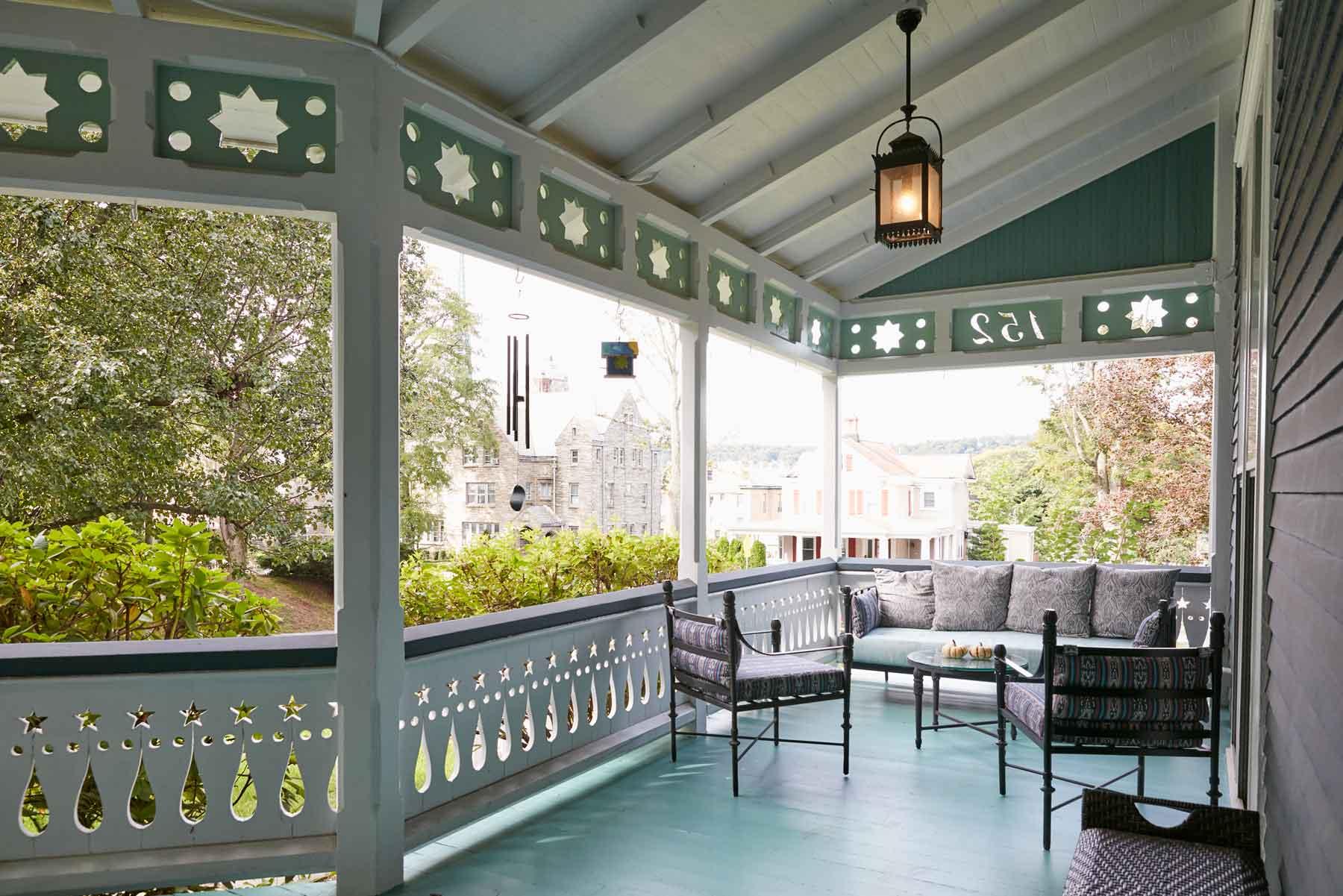 Jess Davis, owner of Nest Studio, veranda front porch in her South Orange NJ Victorian