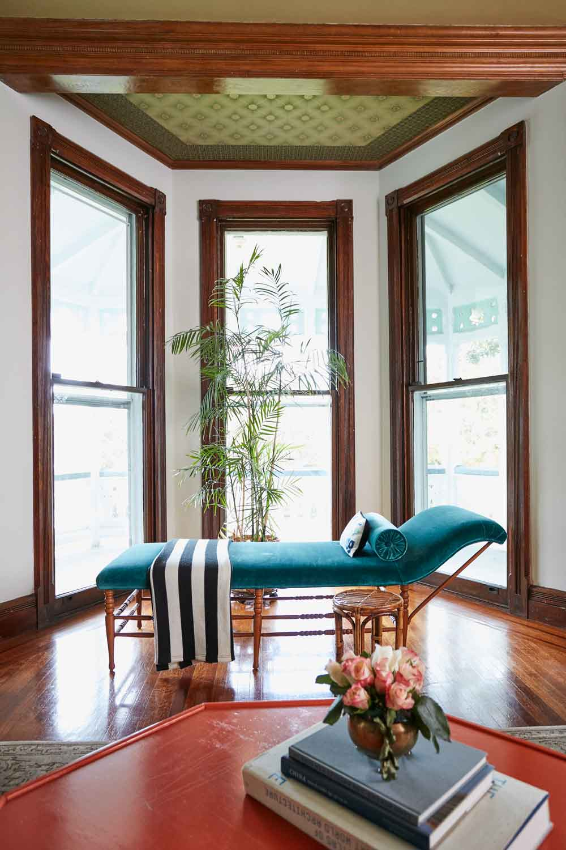 Jess Davis, owner of Nest Studio, bay window chaise lounge interior design in her South Orange NJ Victorian