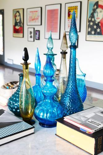 Collection of vintage blue glass bottles.